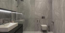 Дизайн туалета с плиткой бренда Progres коллекции Вулкан, матовая, серая, под мрамор